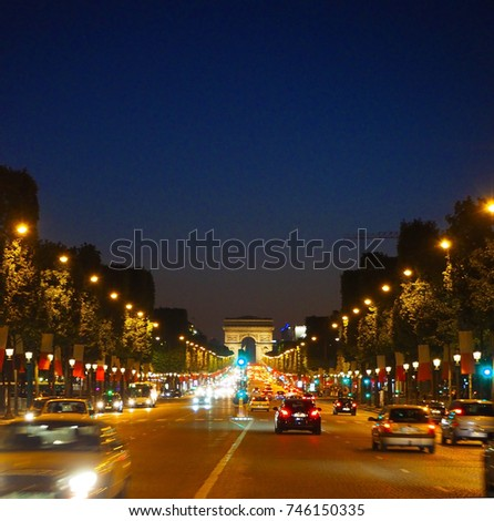 Avenue Champs-Elysees with illumination and triumphal arch on the horizon in Paris, France. Champs Elysees is one of the most famous and famous streets in the world. #746150335