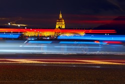 Avenue du Marechal Gallieni in the night , Les Invalides view of famous building in Paris