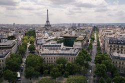 Avenues with Effiel Tower on the background, view from Arc de Triomphe (Paris, France)