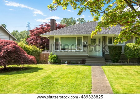 Free Entrance of family house with concrete pathway over green lawn ...