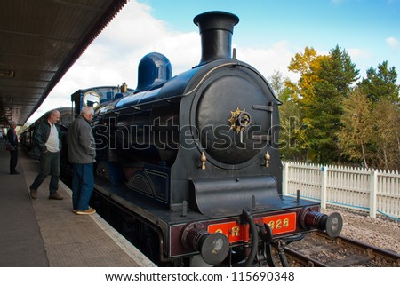 AVIEMORE, SCOTLAND - OCT 7: Caley 828, the world's only surviving Caledonian Railway 0-6-0 tender locomotive on October 7, 2012 in Aviemore, Scotland