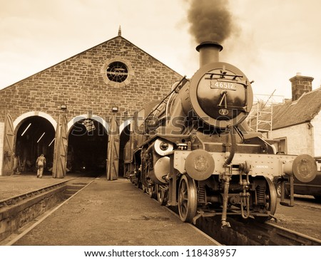 AVIEMORE, SCOTLAND - OCT 27: (Note: Sepia Effect Used) LMS Ivatt 46512 Class 2 2-6-0 locomotive, one of only seven remaining is seen on October 27, 2012 in Aviemore, Scotland - stock photo