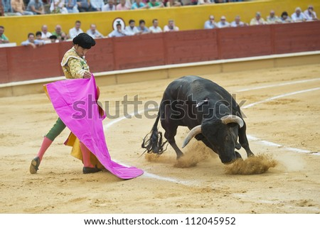 AVILA, SPAIN - JUNE 2: Cesar Jimenez fights in the welfare bullfight of Avila, a city near to Madrid in the middle of Spain in June 2, 2012.