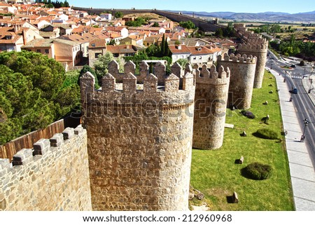 AVILA, SPAIN - JUNE 08, 2014: Old Fortress Walls. The centre of the city is completely encircled by two kilometre long 11th century walls, punctuated by 88 towers and 9 gateways