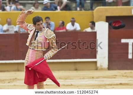 AVILA, SPAIN - JUNE 2: Serafin Marin fights in the welfare bullfight of Avila, a city near to Madrid in the middle of Spain in June 2, 2012.