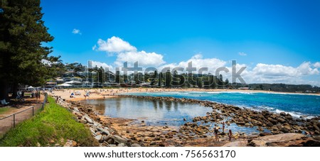 Avoca Beach, Central Coast, Australia - November 12, 2017: Kids playing and People enjoying a sunny day at Avoca Beach on the Central Coast, New South Wales, Australia.