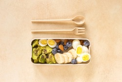Avocado, boiled quail eggs with banana, blueberry and almond on marble background. Ketogenic diet. Low carb high fat breakfast. Healthy food concept