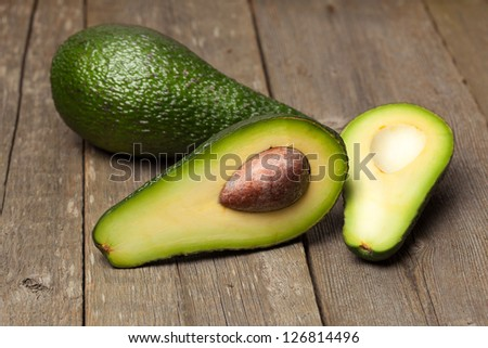 Avocado fruit on a wood background with focus on core