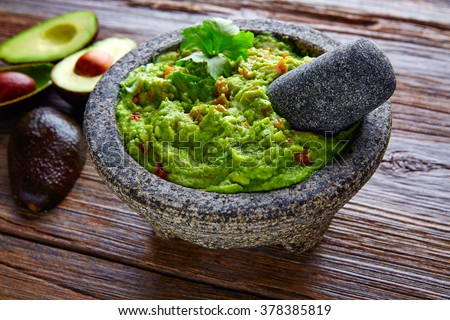 avocado Guacamole on molcajete real Mexican traditional procedure #378385819
