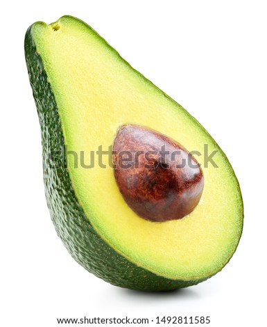 Avocado half isolated on white background. Ripe fresh green avocado Clipping Path