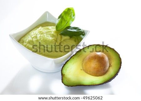 Avocado mousse with halved avocados