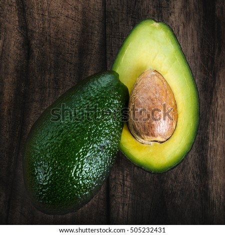 Avocado on a dark wood background close up
