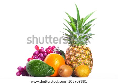 avocado, orange and pineapple isolated on white