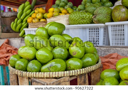 Avocado's in basket in outdoor market, southeast Asia