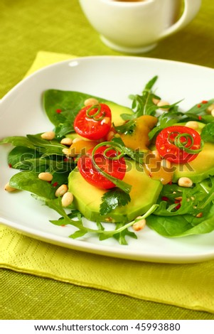 avocado salad with tomatoes,pine nut and honey-mustard sauce