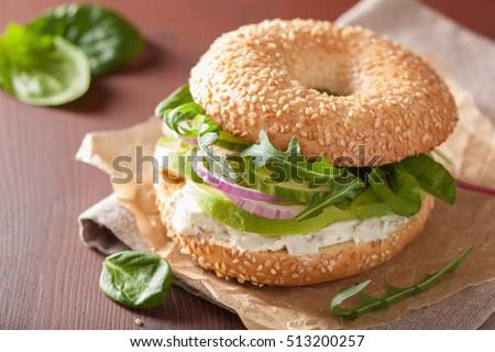 Shutterstock avocado sandwich on bagel with cream cheese onion cucumber arugula