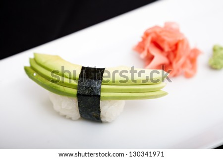 Avocado sushi served on a plate with ginger and wasabi