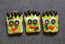 Avocado toast look like as green monster for Halloween