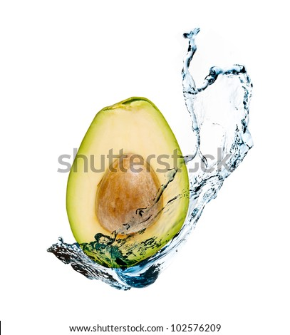 Avocado with water splash is isolated on a white background
