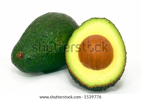 Avocado wole and cut, Green on it's side, isolated white background