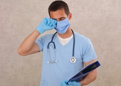 Avoid face touching, Coronavirus prevention, Protection. Overworked male doctor portrait