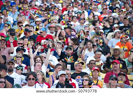 AVONDALE, AZ - APRIL 10: Fans in the grandstand at the Subway Fresh Fit 600 NASCAR Sprint Cup race on April 10, 2010 in Avondale, AZ. - stock photo