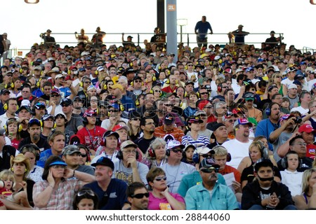 AVONDALE, AZ - APRIL 18: Fans in the grandstand watch the NASCAR Sprint Cup race at the Phoenix International Raceway on April 18, 2009 in Avondale, AZ.