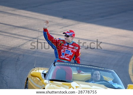 AVONDALE, AZ - APRIL 18: Mark Martin waves to fans during driver introductions for the NASCAR Sprint Cup Series race at Phoenix International Raceway on Saturday, April 18, 2009