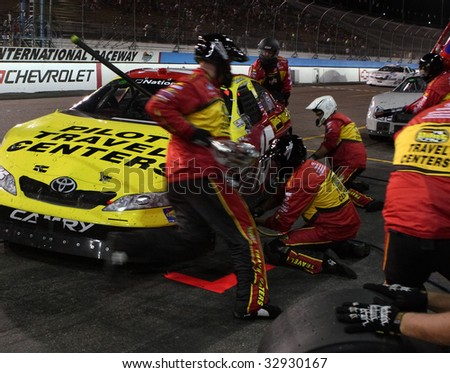 AVONDALE, AZ - APRIL 17: Michael Annett's pit crew make a tire change during one of the caution laps during the NASCAR Nationwide Series at Phoenix International Raceway, on April 17, 2009 - stock photo