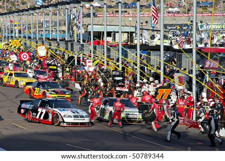 AVONDALE, AZ - APRIL 10: Pit crews change tires and refuel their cars during the Subway Fresh Fit 600 NASCAR Sprint Cup race on April 10, 2010 in Avondale, AZ.