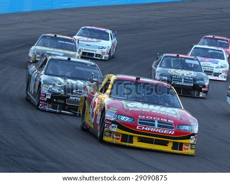 AVONDALE, AZ - APRIL 18: Reed Sorenson (43) tries to stay ahead of a group of cars in the NASCAR Sprint Cup Series race at Phoenix International Raceway April 18, 2009 in Avondale, AZ.