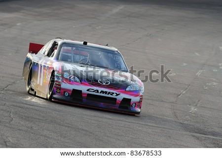 AVONDALE, AZ - FEB 25: Denny Hamlin (11) at speed in a practice session for the SUBWAY Fresh Fit 500 race on Feb. 25, 2011 at the Phoenix International Raceway in Avondale, AZ.