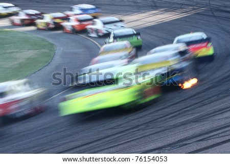 AVONDALE, AZ - NOV 14: Abstract motion-blur of cars at speed in the Kobalt Tools 500 race on Nov 14, 2010 at the Phoenix International Raceway in Avondale, AZ.
