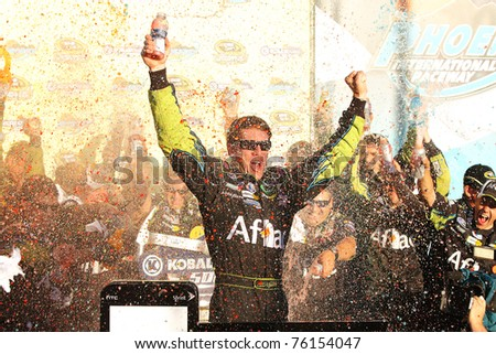 AVONDALE, AZ - NOV 14: Carl Edwards celebrates his victory in the Kobalt Tools 500 race on Nov. 14, 2010 at the Phoenix International Raceway in Avondale, AZ.