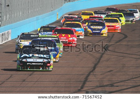 AVONDALE, AZ - NOV 14: Carl Edwards (99) leads the restart for the Kobalt Tools 500 race on Nov 14, 2010 at the Phoenix International Raceway in Avondale, AZ.