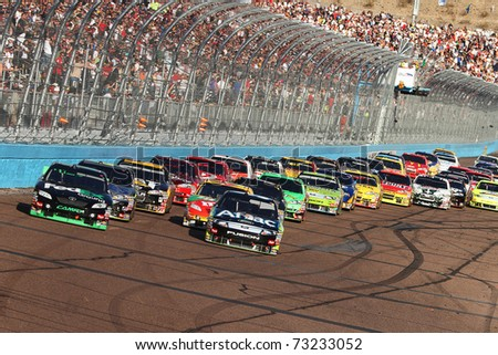 AVONDALE, AZ - NOV 14: Denny Hamlin (11) and Carl Edwards (99) lead the field on a restart for the Kobalt Tools 500 race on Nov 14, 2010 at the Phoenix International Raceway in Avondale, AZ.