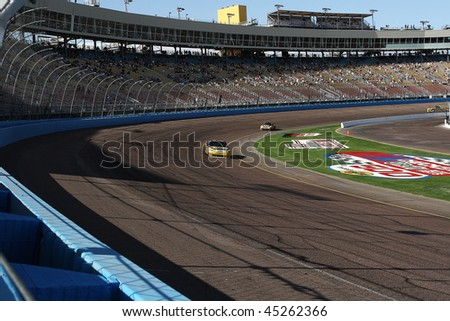 AVONDALE, AZ - NOV. 14: Fans watch a practice session for the NASCAR Sprint Cup Checker O'Reilly Auto Parts 500 race, at Phoenix International Raceway on Nov. 14, 2009 in Avondale, AZ.