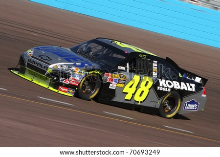 AVONDALE, AZ - NOV 13: Jimmie Johnson (48) takes laps during a practice session for the Kobalt Tools 500 race on Nov 13, 2010 at the Phoenix International Raceway in Avondale, AZ.