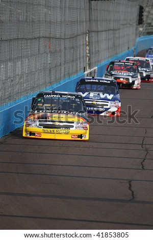 AVONDALE, AZ - NOV. 12: Kevin Harvick (4) leads a line of trucks down the front straight during practice for the Lucas Oil 150 at Phoenix International Raceway on Nov. 12, 2009 in Avondale, AZ.