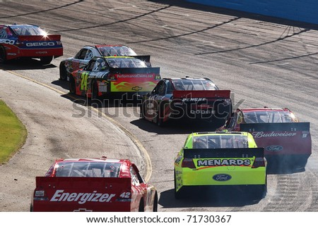 AVONDALE, AZ - NOV 14: NASCAR Sprint Cup cars in turn one during the Kobalt Tools 500 race on Nov 14, 2010 at the Phoenix International Raceway in Avondale, AZ.