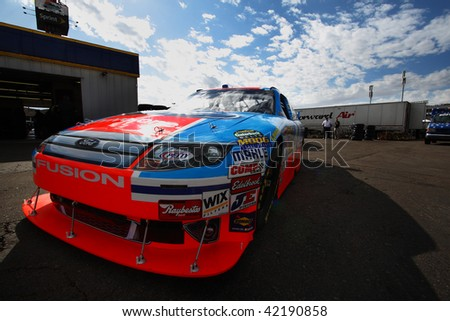 AVONDALE, AZ - NOVEMBER 13: A.J. Allmendinger waits in his car for a practice session for the NASCAR Sprint Cup Series, at Phoenix International Raceway on November 13, 2009 in Avondale, AZ.