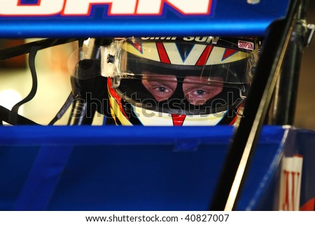 "AVONDALE, AZ - NOVEMBER 12: Brad Kuhn focus' on placing well before the start of the ""Copper World Classic"" race at Phoenix International Raceway on November 12, 2009 in Avondale, AZ."