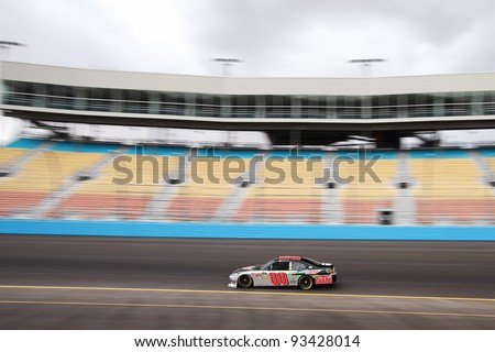 AVONDALE, AZ - OCT 4: Dale Earnhardt Jr. (88) takes laps during a NASCAR Sprint Cup track testing session on Oct. 4, 2011 at Phoenix International Raceway in Avondale, AZ.