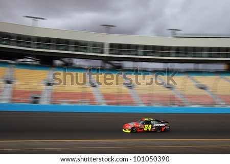 AVONDALE, AZ - OCT 4: Jeff Gordon (24) takes laps during a NASCAR Sprint Cup track testing session on Oct. 4, 2011 at Phoenix International Raceway in Avondale, AZ.