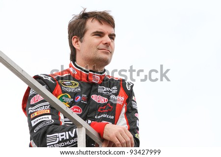 AVONDALE, AZ - OCT 4: Jeff Gordon watches from the top of the team hauler during a track testing session on Oct. 4, 2011 at Phoenix International Raceway in Avondale, AZ.