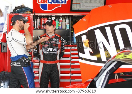AVONDALE, AZ - OCT 4: Jimmie Johnson (left) talks with Jeff Gordon during a track testing session on Oct. 4, 2011 at Phoenix International Raceway in Avondale, AZ.