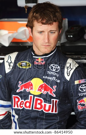 AVONDALE, AZ - OCT 4: Kasey Kahne (4) waits as the team make adjustments to his car during a track testing session on Oct. 4, 2011 at Phoenix International Raceway in Avondale, AZ.