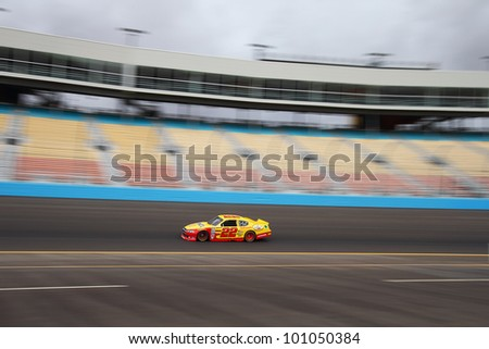 AVONDALE, AZ - OCT 4: Kurt Busch (22) takes laps during a NASCAR Sprint Cup track testing session on Oct. 4, 2011 at Phoenix International Raceway in Avondale, AZ.