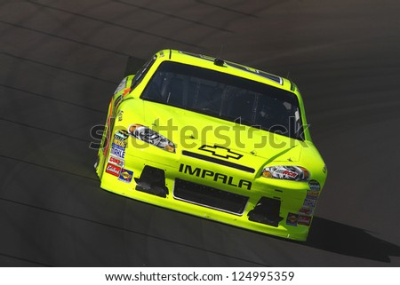 AVONDALE, AZ - OCT 5: Paul Menard (27) takes hot laps during a NASCAR Sprint Cup track testing session on Oct. 5, 2011 at Phoenix International Raceway in Avondale, AZ.