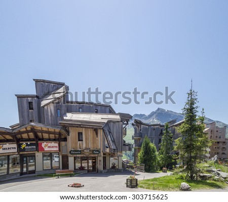 AVORIAZ , FRANCE - JULY 7, 2015. Strange wooden  buildings in  Avoriaz , French mountain resort, in the middle of the Porte du Soleil , Alps Mountains.